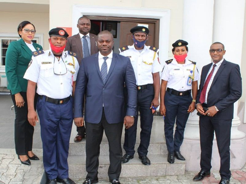 Fire service officials with EFCC officials